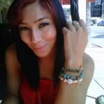 Roc Nation's Bridget Kelly wearing custom MM bracelets April 2011